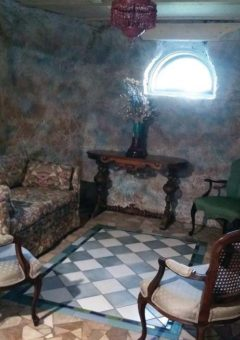 Room with chairs and patterned wall