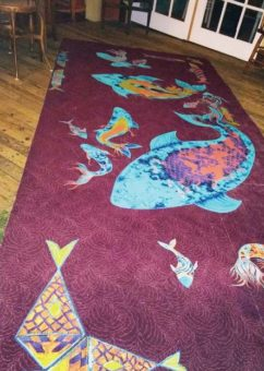 purple rug with colorful fish
