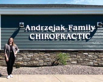 Dr. Lindsay Andrzejak standing outside her Andrzejak Family Chiropractic building.