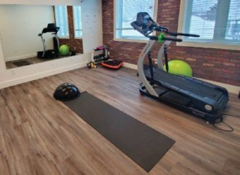 Treadmills with yoga mats on floor