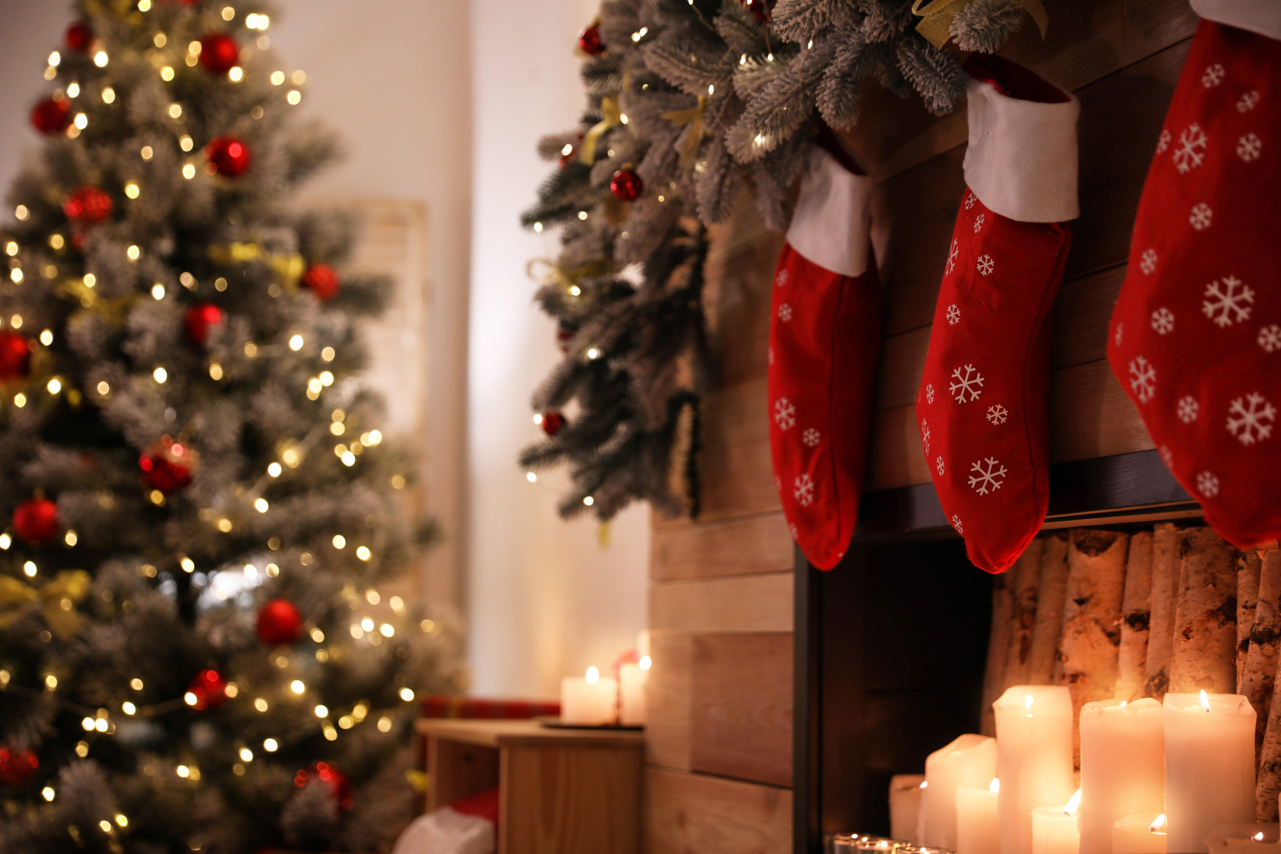 Christmas tree and stockings by the fireplace.