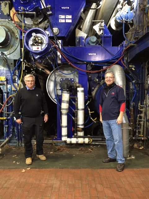 President & CEO Lars Dannberg and General Manager Greg Anderson stand in front of one of the paper machines.