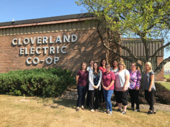 Group of people standing outside of the Cloverland Electric Co-op Office
